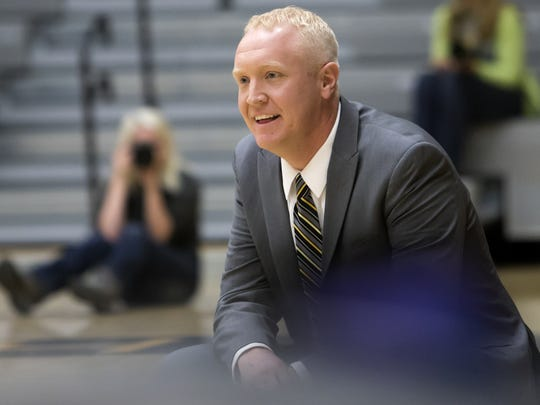 UW-Oshkosh head coach Brad Fischer watches the court action between the Titans and the Pointers on Saturday, Jan. 16, 2016, at the Kolf Sports Center.