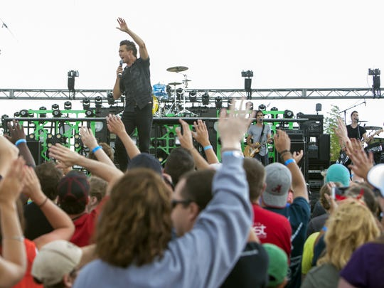 Citizen Way performed on the Lifest main stage Friday in Oshkosh. The largest Christian music festival in Wisconsin attracted an average of 23,000 people each day.