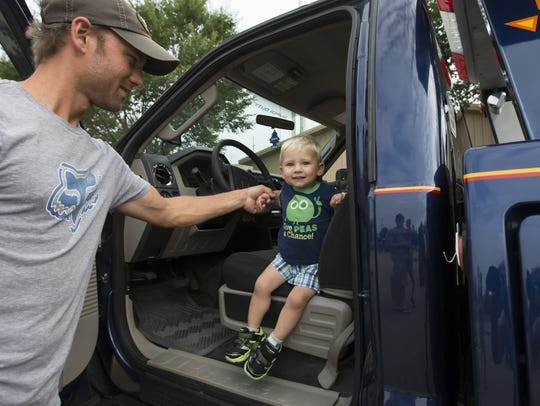 Ethan Waldschmidt gets helps from his dad after being