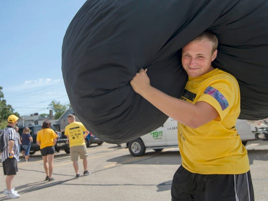 Andy Hooyman, a freshman, gives a helping hand to other students moving to campus on Sunday at the University of Wisconsin-Oshkosh.