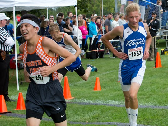Diego Charbonneau (267) of North Fond du Lac and Theo Kobza (1553) of Assumption cross the finish line in the 2016 Lourdes Academy Cross Country Invitational.