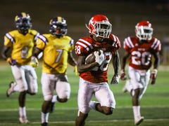 Sawyer carrying load as Ruston running back
