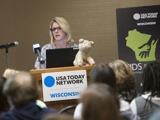 Kris Cahak shares the story about the loss of her daughter Morgan Pieper to suicide during a Kids in Crisis town hall Thursday, March 16, 2017, at the Best Western Premier Waterfront Hotel in Oshkosh. Cahak hopes others will learn to identify signs to get help before it is too late.