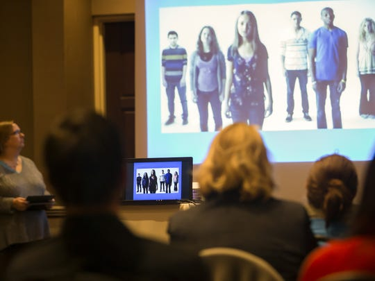 People watch a short video during QPR (Question, Persuade, Refer) suicide-prevention training Thursday, March 16, 2017, at the Best Western Premier Waterfront Hotel in Oshkosh.