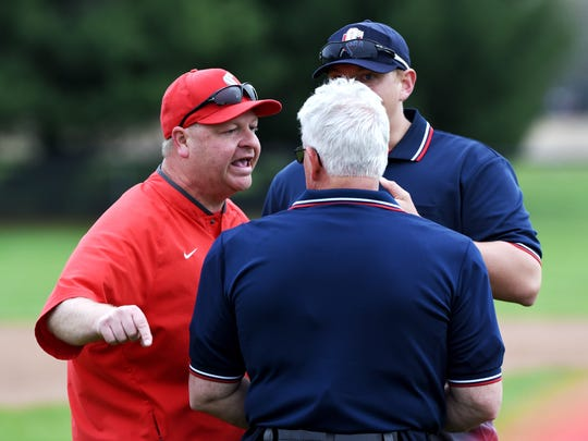 Sheridan coach Doug Fisher argues with umpires following