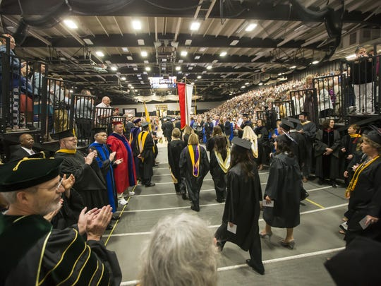 The processional begins for graduates of the University of Wisconsin-Oshkosh Saturday at the Kolf Sports Center May 13, 2017.