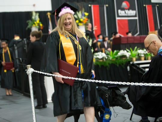 Jacquelynn Miller receives her diploma from Fox Valley