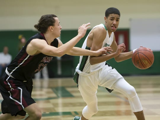 Tyrese Haliburton drives to the hoop in a high school basketball game for Oshkosh North. Haliburton ended his high school career as a three-star recruit with few high-major scholarship offers, before blossoming into an NBA prospect after two years at Iowa State.