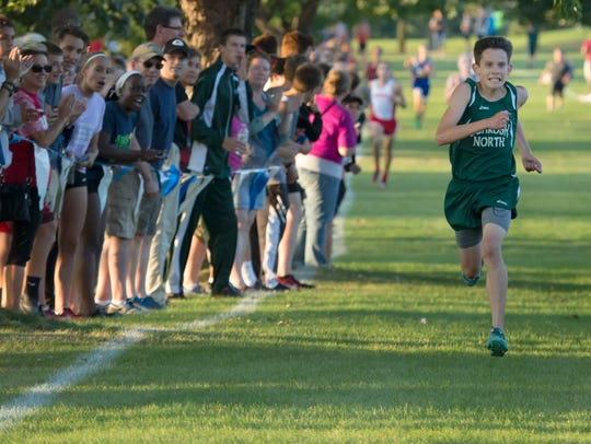 Oshkosh North's Jack Scherer pushes to the finish line to place second in the large school division of the 2017 Winneconne cross country invite.