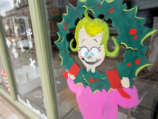 Oshkosh Area School District art students painted Whoville scenes on downtown storefronts Oct. 30 in Oshkosh.