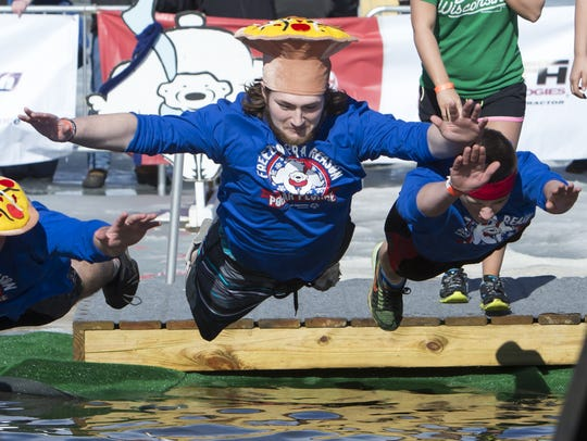 People take the plunge on a spring-like day last February during the Oshkosh Polar Plunge at Menominee Park. This year's plunge is Feb. 15 and 16.