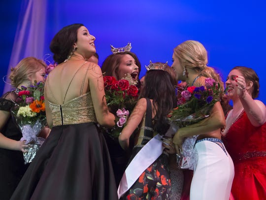 Contestants in the scholarship pageant surround newly crowned Miss Oshkosh Kate Lidtke Saturday at the Alberta Kimball Auditorium in Oshkosh.