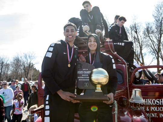 Tyrese Haliburton and Quincy Anderson hold the state championship trophy during a welcome-home celebration in March at Oshkosh North.