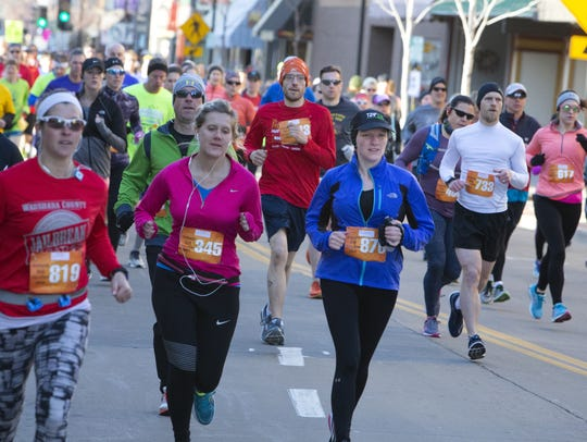 Runners from last year's Oshkosh Marathon run down Main Street. This year's event will take place April 28.