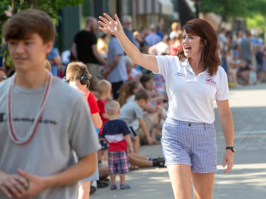Rebecca Kleefisch meets and greets people along the Oshkosh Independence Day Parade route on Wednesday, July 4, 2018. After eight years as lieutenant governor she is now the executive director of the Women's Suffrage Centennial Commission.