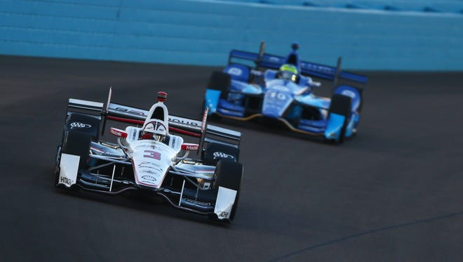 Verizon IndyCar Series driver Helio Castroneves leads Tony Kanaan during the Phoenix Grand Prix at Phoenix International Raceway.