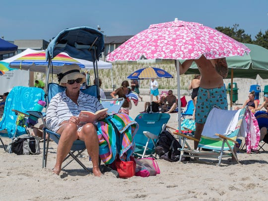 A beach etiquette expert recommends keeping 5 feet from your next nearest neighbor on the beach, unlike this typical scene in Beach Haven, N.J.