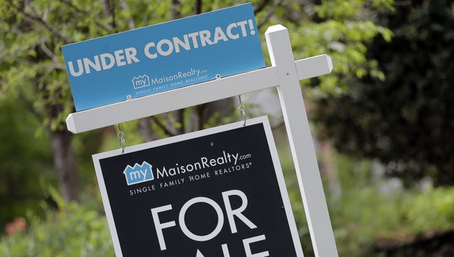 """An """"Under Contract"""" sign is posted in front of a home for sale in Charlotte, N.C."""