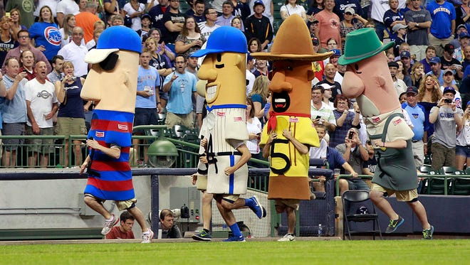 The popular Klement's Racing Sausages begin their regular middle-of-the-sixth-inning race at Miller Park during the Brewers' game against the Chicago Cubs June 25, 2013. The Racing Sausages were celebrating their 20th year with the Brewers.