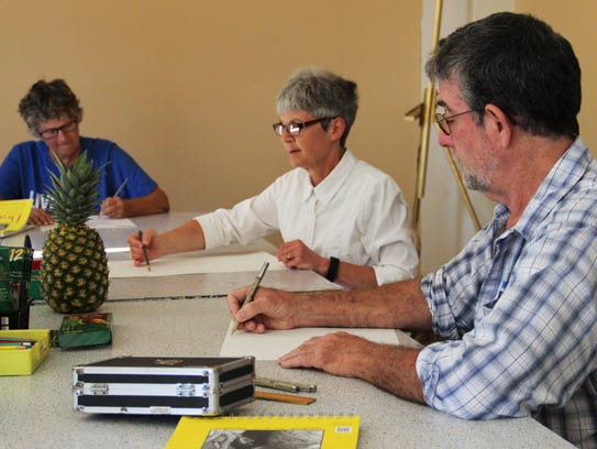 Adults take a drawing class at Cornerstone Center for