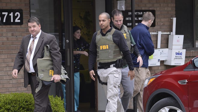 FBI agents last month raid the office of Dr. Fakhruddin Attar at the Burhani Clinic in Livonia.