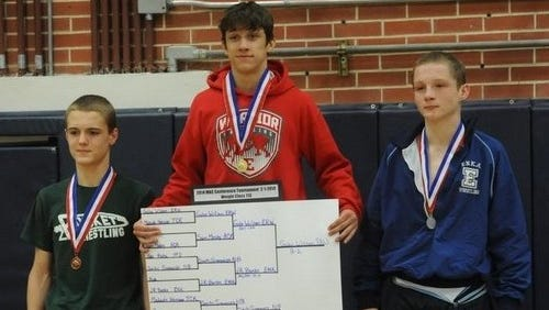 Erwin's Gabe Wilson, center, is a member of the Strong & Courageous wrestling club.