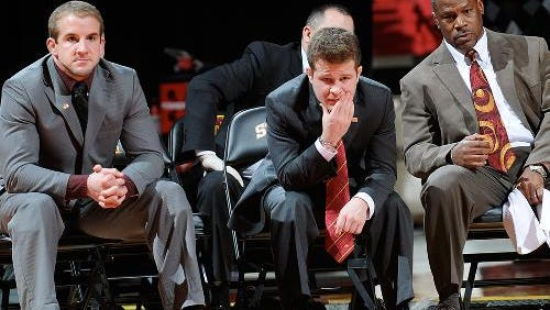 Iowa State assistant Troy Nickerson (center) was hired Monday by Northern Colorado as its head wrestling coach.