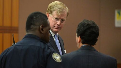 U.S. District Court Judge Mark Fuller appears in Fulton County Court Friday, Sept. 5, 2014 to face charges of misdemeanor battery, in Atlanta. Under terms agreed to Friday, Fuller, from Alabama, will be allowed to enter a court program to resolve a misdemeanor battery case against him that involved allegations he hit his wife during a fight at an Atlanta hotel.