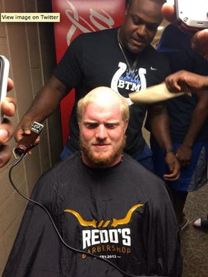 """Cory Redding (top) gives Indianapolis Colts rookie Jack Mewhort a """"haircut."""""""