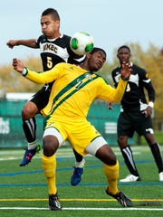 Vermont's Brian Wright (7) and UMBC's Marquez Fernandez (5) battle for the ball during the men's soccer game last season.