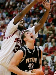 Before he was a Colts lineman, Reitz was a center on the Western Michigan basketball team. Here, he looks for a hoop vs. Indiana's D.J. White in 2006.