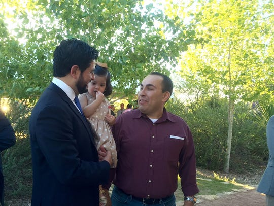 David Saucedo holds his 18-month-old daughter Ana Regina