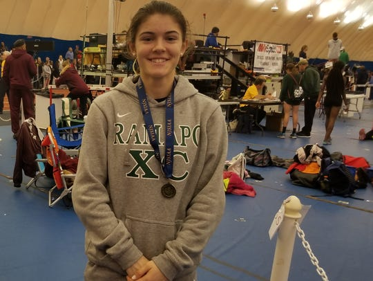 Grace O'Shea of Ramapo indoor girls track showing off