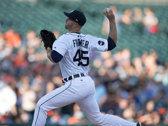 Tigers' Buck Farmer pitches against the Angels in the