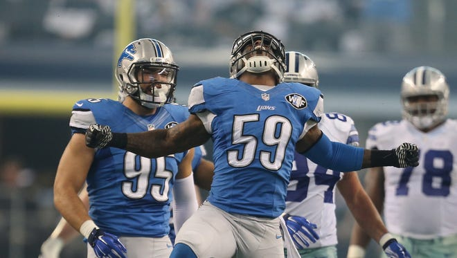 Lions linebacker Tahir Whitehead celebrates a sack against the Cowboys on Jan. 4, 2015 at AT&T Stadium in Arlington, Texas.