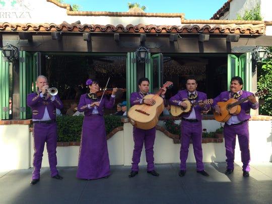 A Mariachi Tesoro performs outside Las Casuelas Terraza