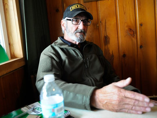 Retired U.S. Army Sgt. Maj. Joseph Santoro discusses the situation at the White Hope Mine, Wednesday, Aug. 5, 2015, in Lincoln, Mont. According to Santoro the Oath Keepers and other constitutionalist groups are protecting the rights of the White Hope Mine claimants.