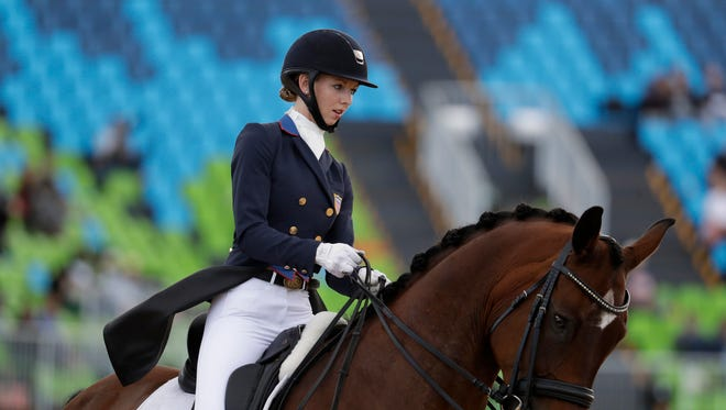 United States' Laura Graves, riding Verdades, competes in the equestrian dressage competition at the 2016 Summer Olympics in Rio de Janeiro, Brazil, Friday, Aug. 12, 2016.