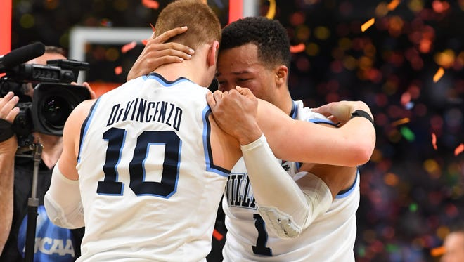 Villanova Wildcats guard Donte DiVincenzo (10) celebrates with Jalen Brunson (1) after defeating the Michigan Wolverines 79-62 in the championship game of the 2018 men's Final Four at Alamodome.