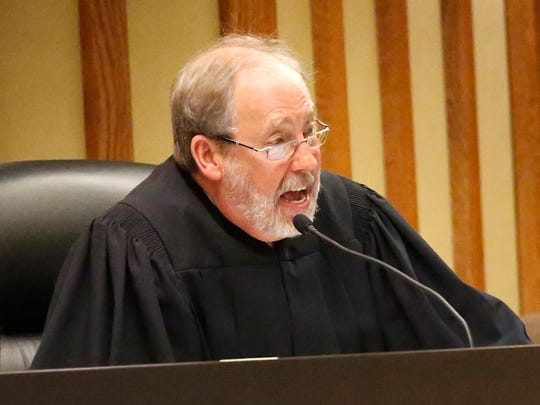 Judge Gary Sharpe addresses potential jurors in a Fond du Lac County courtroom Tuesday during jury selection for Dennis Brantner's murder trial. He is accused of the the 1990 slaying of Berit Beck.