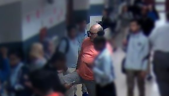 This screengrab from a surveillance video allegedly shows a student being kicked by Vice Principal Mounir Almaita. The image has been blurred to protect students' identities.