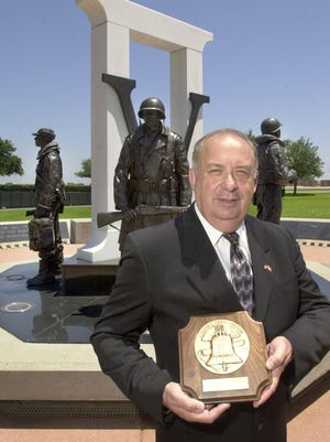 Retired U.S. Marine Capt. John Pritchard Foundation, received the 2004 Liberty Bell Award for his efforts in developing the Veterans Memorial Park in downtown Pensacola.