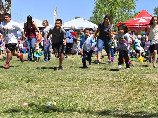 Kids sprint in search of Easter eggs at the 2017 Easter