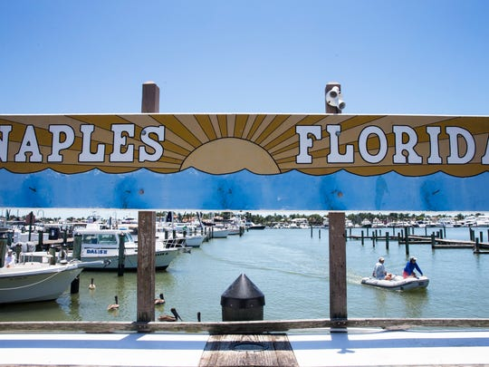 A boat pulls in to dock at the Naples City Dock on