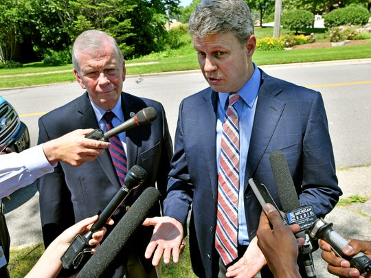 U.S. Reps Tim Walberg, R-Tipton, left, and Bill Huizenga, R-Zeeland, talk with the media outside Bethany Christian Services in Grand Rapids on Friday, after they said they were turned away from a visit at one of the organization's facilities where refugee children were being housed.