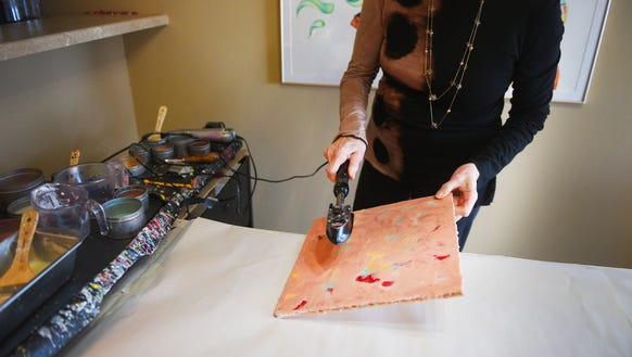 Local artist Carolyn Heizer demonstrates how she created