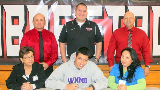 Cobre High School's Damon Rivera signs a letter of intent to play football for Western New Mexico University.