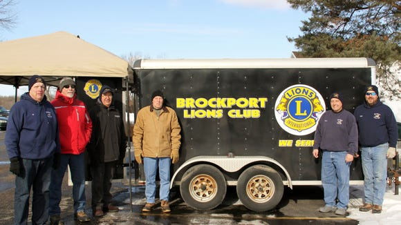 Members of the Brockport Lion's Club collecting food for the Brockport Food Shelf. photo by Caurie Putnam