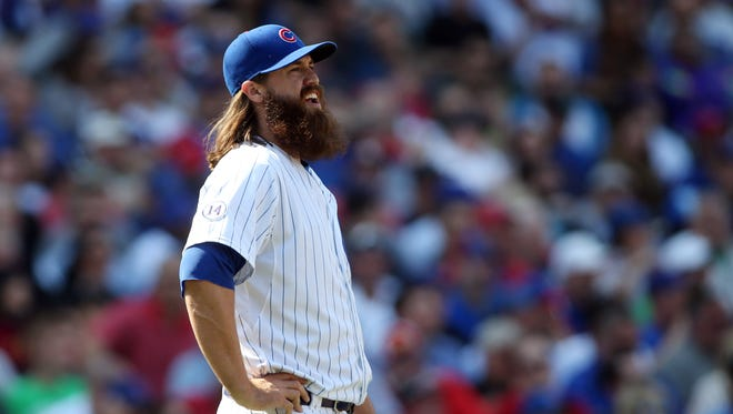 Chicago Cubs relief pitcher Brian Schlitter reacts during the game against the San Diego Padres at Wrigley Field. Mandatory Credit: Jerry Lai-USA TODAY Sports