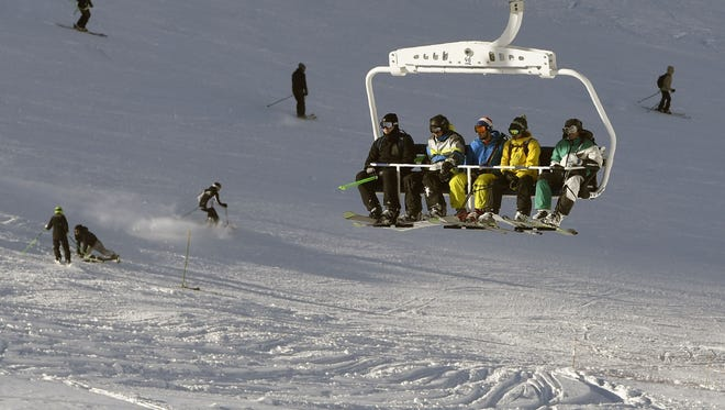 This file photo taken on Nov. 26, 2016 shows people sitting in a ski lift on the opening weekend of the ski season  at Val Thorens ski resort, in the French Alps.